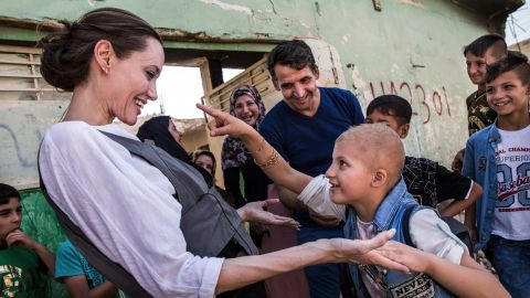 UNHCR Special Envoy Angelina Jolie meets a child during a visit on June 16, 2018, to Mosul, Iraq.