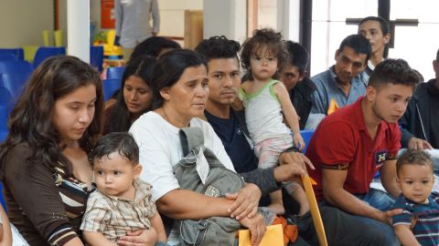 Migrants wait to be assisted by volunteers in a Humanitarian Respite Center in the border town of McAllen, Texas on June 14, 2018. (Photo by Leila Macor / AFP)        (Photo credit should read LEILA MACOR/AFP/Getty Images)
