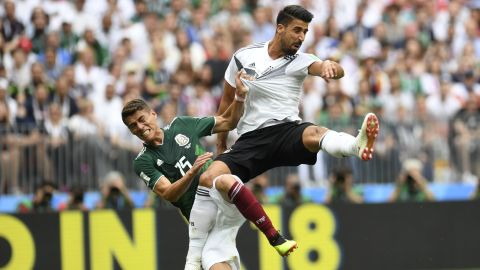 Germany's midfielder Sami Khedira, right, and Mexico's defender Hector Moreno fall after attempting to head the ball during the World Cup match between Germany and Mexico in Moscow on Sunday.