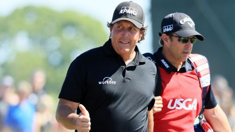 """Phil Mickelson was back a day after sparking the """"putt-gate"""" controversy when he hit his still moving ball back towards the hole. The left-hander, who improved on Saturday's 81 with a closing 69 to end +16, declined to offer any further comment on the incident."""