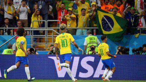 Philippe Coutinho celebrates his opening goal against Switzerland.