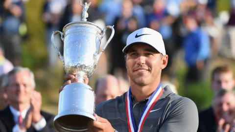 Brooks Koepka became the seventh man to win back-to-back US Open titles after overcoming a testing and controversial week at Shinnecock Hills.