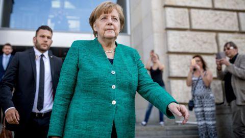 Merkel leaves the German parliament after a CDU leadership meeting Thursday.