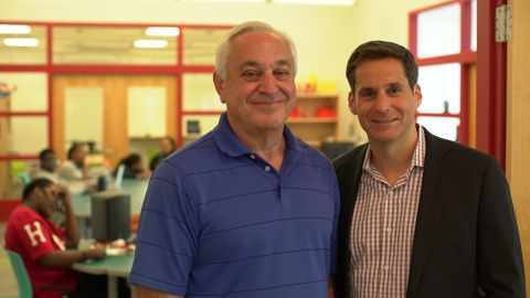 Carl Ship, left, West End House volunteer, and CNN's John Berman.