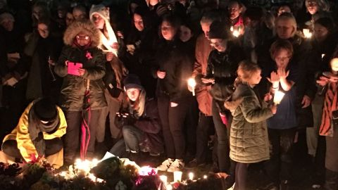 """The """"Reclaim Prince's Park"""" vigil held Monday night saw mourners light candles and lay flowers at the site where the body of Eurydice Dixon was found."""