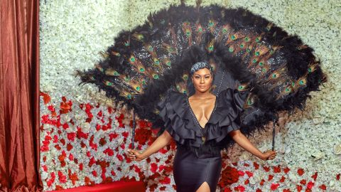 The actress wore a stunning peacock feathered cape designed by costumier Africana.