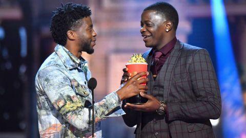 SANTA MONICA, CA - JUNE 16:  James Shaw Jr. accepts award from Actor Chadwick Boseman onstage at the 2018 MTV Movie And TV Awards at Barker Hangar on June 16, 2018 in Santa Monica, California.  (Photo by Jeff Kravitz/FilmMagic)