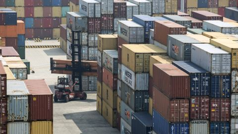 A reach stacker transports a shipping container in a terminal at the Yangshan Deep Water Port in Shanghai, China, on Friday, March 23, 2018. The trade conflict between China and the U.S. escalated, with Beijing announcing its first retaliation against metals levies hours afterPresidentDonald Trumpoutlined fresh tariffs on $50 billion of Chinese imports and pledged there's more on the way. Photographer: Qilai Shen/Bloomberg via Getty Images