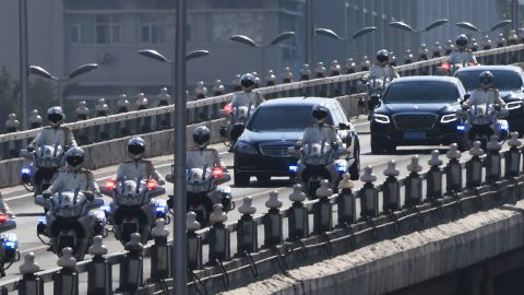 The car believed to be carrying North Korean leader Kim Jong Un is escorted by motorcycles in Beijing on Tuesday.