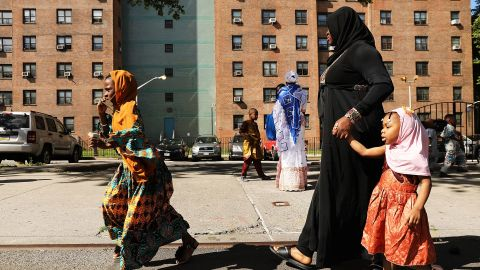 West African women after participating in an outdoor prayer event  to mark the end of Ramadan on June 15 in New York City.