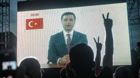 Supporters watch a recorded speech by imprisoned candidate Selahattin Demirtas at a rally in Istanbul on June 17.