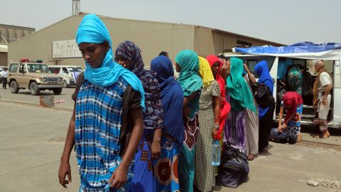 Ethiopian migrants queue to board a ship repatriating them home via Djibouti, in the Yemeni rebel-held Red Sea port of Hodeida on June 2, 2018. (Photo by ABDO HYDER / AFP)        (Photo credit should read ABDO HYDER/AFP/Getty Images)