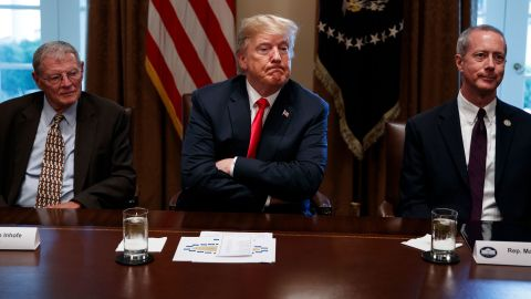 President Donald Trump pauses during a meeting with Republican members of Congress on immigration in the Cabinet Room of the White House, Wednesday, June 20, 2018, in Washington. From left, Sen. Jim Inhofe, R-Okla., Trump, and Rep. Mac Thornberry, R-Texas. (AP Photo/Evan Vucci)