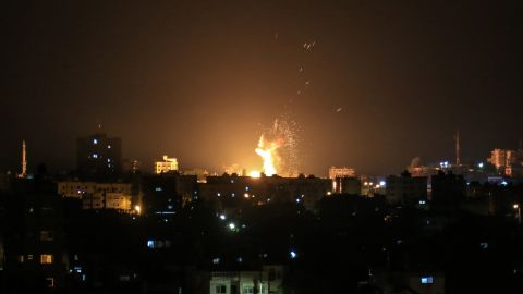 An explosion is seen in northern Gaza City after an airstrike by Israeli forces on June 20, 2018.