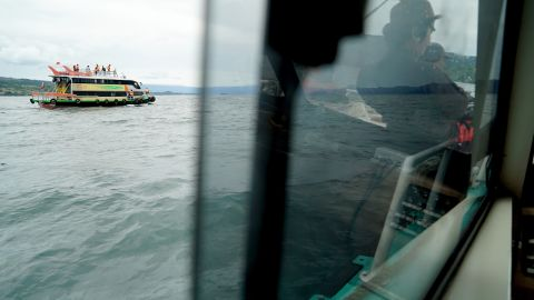 Rescue teams search for victims at the Lake Toba ferry port in the province of North Sumatra.
