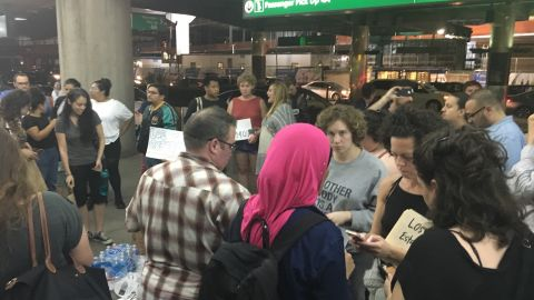 Crowds gathered at LaGuardia Airport where it is believed some immigrant children arrived Wednesday night.