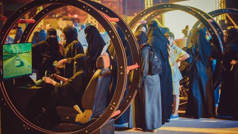 Women take part in a government-organized road safety event at Riyadh Park Mall, in the Saudi capital, on Thursday.