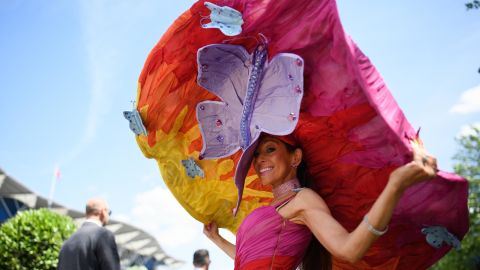 ASCOT, ENGLAND - JUNE 21:  A racegoer wears an outsize hat for Ladies Day during Royal Ascot Day 3 at Ascot Racecourse on June 21, 2018 in Ascot, United Kingdom. Royal Ascot is Britain's most valuable race meeting, attracting many of the world's finest racehorses to compete for more than £7.3m in prize money.  (Photo by Leon Neal/Getty Images)