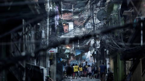 <strong>Rio de Janeiro, Brazil: </strong>Residents of Rocinha, Rio's largest favela, play on the street following the Brazil vs Switzerland World Cup match on June 17. <br />