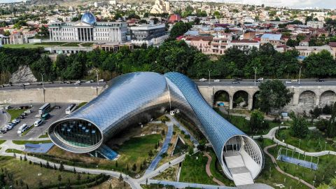 <strong>Tbilisi, Georgia: </strong>A drone captured this image of the Georgian capital's futuristic Rhike Park theater and exhibition hall (center), and the ultraclassical Presidential Palace (pictured behind). <br /><br />