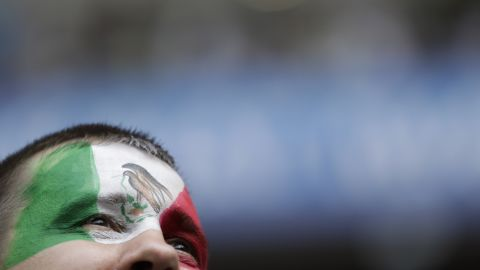 A Mexico fan waits for the start of the match against South Korea.