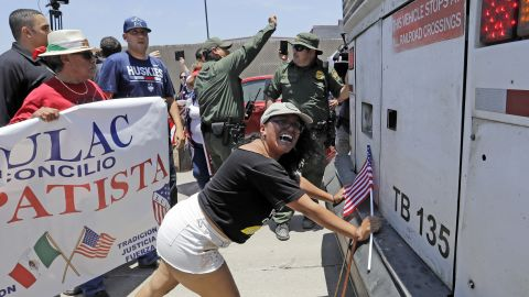 Demonstrator Martha Mercado tries to stop a bus with immigrant children onboard during a protest outside the U.S. Border Patrol Central Processing Center Saturday, June 23, 2018, in McAllen, Texas.