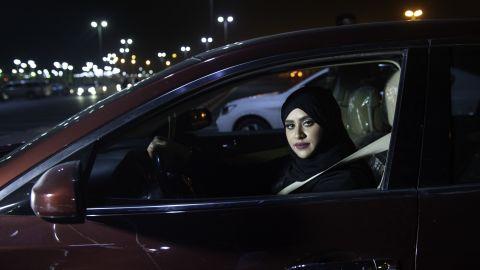 Saudi woman Sabika Habib drives her car through the streets of Khobar City on her way to Bahrain on Sunday.
