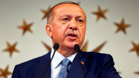 Turkey's President Recep Tayyip Erdogan delivers a statement on national television from his official residence in Istanbul, Sunday, June 24, 2018. Erdogan has claimed victory in critical elections based on unofficial results, securing an executive presidency with sweeping powers. (AP Photo/Lefteris Pitarakis)