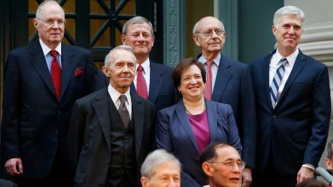 Several members of the Supreme Court pose for a portrait before taking part in a procession to mark Harvard Law School's bicentennial in October 2017. On the top row, from left, are Kennedy, Roberts, Breyer and Gorsuch. In front of them are Kagan and retired Supreme Court Justice David Souter.