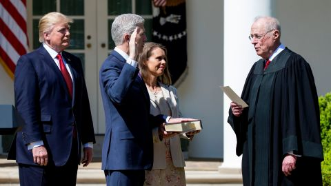 As President Trump looks on, Kennedy administers the judicial oath to new Justice Neil Gorsuch in April 2017.