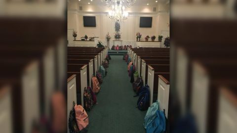 Backpacks line a church's aisle at the funeral for teacher Tammy Waddell.