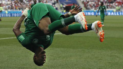 Salem Al-Dawsari celebrates with a flip after scoring the match-winning goal against Egypt.