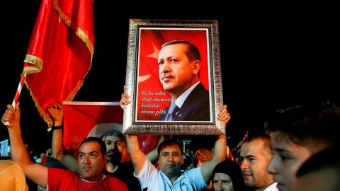 Supporters of Turkey's President Recep Tayyip Erdogan listen as he addresses them outside his official residence in Istanbul, Sunday, June 24, 2018. Erdogan has claimed victory in critical elections based on unofficial results, securing an executive presidency with sweeping powers. (AP Photo/Lefteris Pitarakis)