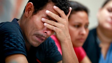 Melvin, foreground, and Iris, both from Honduras, listen as they hear other immigrants tell of their separation from their children at the border during a news conference at the Annunciation House, Monday, June 25, 2018, in El Paso, Texas. 32 parents waiting to be reconciled with their children have been released by Border Patrol the the Annunciation House. (AP Photo/Matt York)