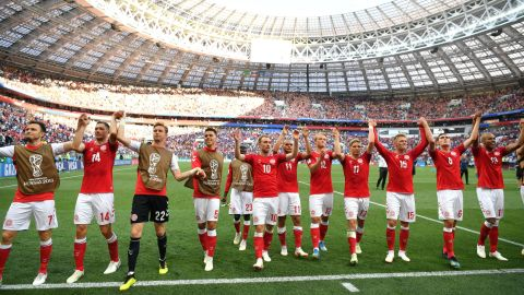 Danish players acknowledge fans after their scoreless draw with France on June 26. Both teams advanced to the knockout stage.