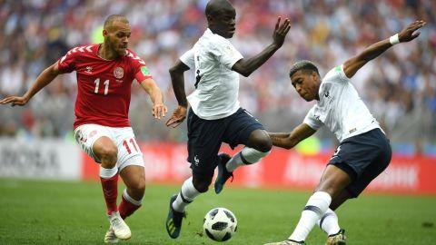 Denmark's Martin Braithwaite, left, is tracked by France's N'Golo Kante, center,  and Presnel Kimpembe.