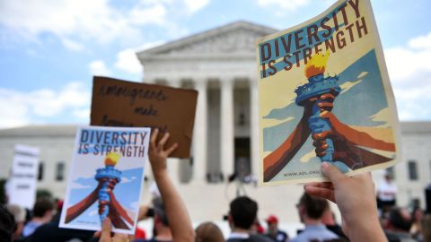 People protest the Muslim travel ban outside of the US Supreme Court in Washington, DC on June 26, 2018. - The US Supreme Court on Tuesday upheld President Donald Trump's controversial ban on travelers from five mostly Muslim countries -- a major victory for the Republican leader after a tortuous legal battle. In a majority opinion written by Chief Justice John Roberts, the court ruled 5-4 that the most recent version of the ban, which the administration claims is justified by national security concerns, was valid. (Photo by MANDEL NGAN / AFP)        (Photo credit should read MANDEL NGAN/AFP/Getty Images)