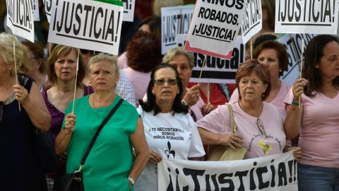 """Demonstrators holding placards reading """"Justice"""" outside the court Tuesday."""