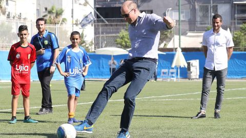 The Duke of Cambridge takes a penalty kick as he visits a football-based youth programme on Tuesday.