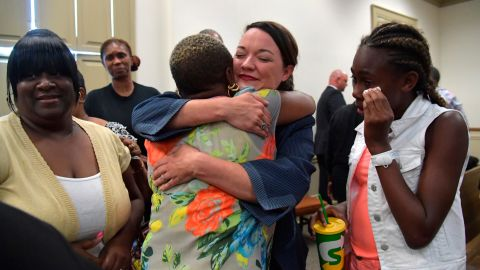 Broder, center, celebrates the Gebhardt verdict with Coggins' family and friends in June.