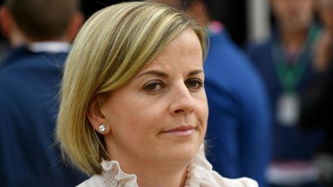 British former racing driver Susie Wolff arrives in the pit lane ahead of the British Formula One Grand Prix at the Silverstone motor racing circuit in Silverstone, central England on July 16, 2017. / AFP PHOTO / Andrej ISAKOVIC        (Photo credit should read ANDREJ ISAKOVIC/AFP/Getty Images)