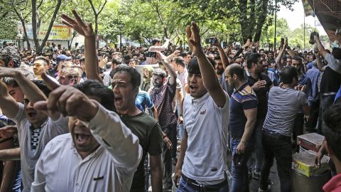A group of protesters chant slogans at the old grand bazaar in Tehran, Iran, Monday, June 25, 2018. Protesters in the Iranian capital swarmed its historic Grand Bazaar on Monday, news agencies reported, and forced shopkeepers to close their stalls in apparent anger over the Islamic Republic's troubled economy, months after similar demonstrations rocked the country. Iranian Labor News Agency/AP