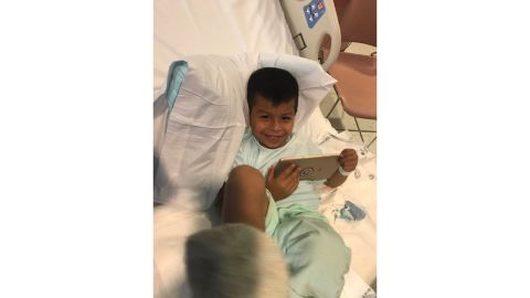 5-year-old Vincent recovers in the hospital after being saved by Mozqueda.