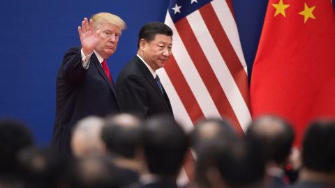 """TOPSHOT - US President Donald Trump (L) and China's President Xi Jinping leave a business leaders event at the Great Hall of the People in Beijing on November 9, 2017. Donald Trump urged Chinese leader Xi Jinping to work """"hard"""" and act fast to help resolve the North Korean nuclear crisis, during their meeting in Beijing on November 9, warning that """"time is quickly running out"""". / AFP PHOTO / Nicolas ASFOURI        (Photo credit should read NICOLAS ASFOURI/AFP/Getty Images)"""