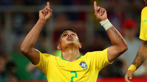 Brazilian defender Thiago Silva celebrates after his powerful header gave Brazil a 2-0 lead over Serbia on June 27. Brazil won Group E with two victories and a draw.