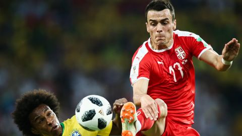 Brazil's Willian and Serbia's Filip Kostic fight for the ball.
