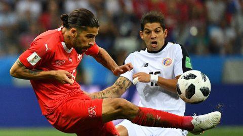 Costa Rican defender Cristian Gamboa, right, closes in on Switzerland's Ricardo Rodriguez.