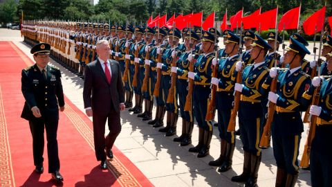 US Defence Secretary Jim Mattis and China's Defence Minister Wei Fenghe inspect and honour guard during a welcome ceremony at the Bayi Building in Beijing on June 27, 2018.