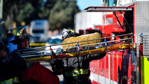 A stretcher is taken out of a fire truck at the scene of a fire that destroyed a warehouse on December. 3, 2016, in Oakland, Calif. A deadly fire broke out during a rave at the converted warehouse in the San Francisco Bay Area.