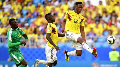 Colombian defender Yerry Mina controls the ball during a match against Senegal on June 28. Mina headed in a second-half goal to lift his team to a 1-0 victory -- and first place in Group H.